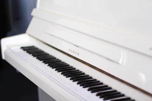 White Samick upright piano