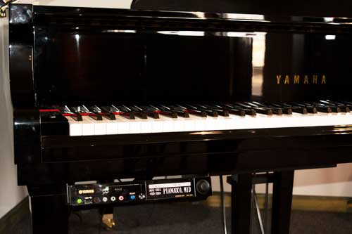 Yamaha Grand Player piano in polished black