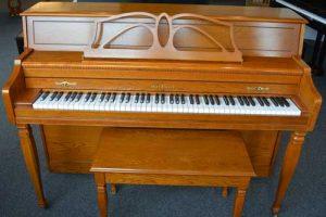 Baldwin Upright Piano in Oak at 88 Keys Piano Warehouse