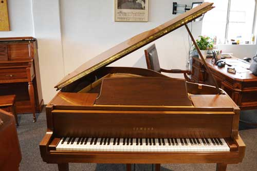 Yamaha grand piano in oak