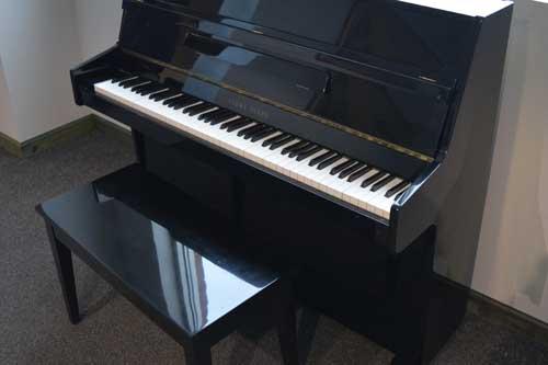 Polished ebony Young Chang upright piano