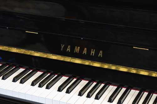 Yamaha upright piano logo at 88 Keys Piano Warehouse