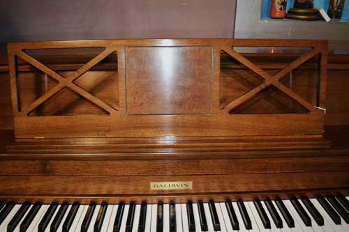 Baldwin Consolette piano burl walnut music rack at 88 Keys Piano Warehouse