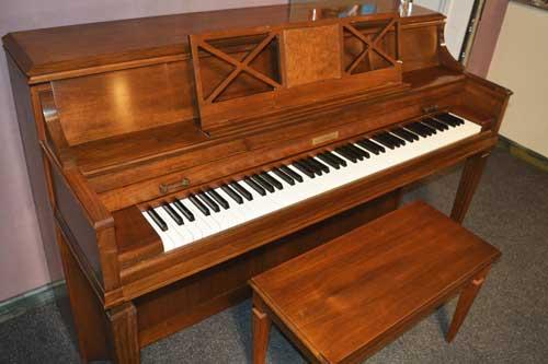 Baldwin Consoolette piano with burl walnut at 88 Keys Piano Warehouse