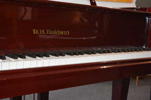 DH baldwin Grand Piano logo At 88 Keys Piano Warehouse