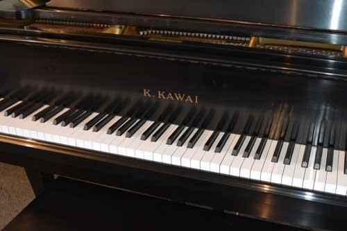 Kawai grand piano logo At 88 Keys Piano Warehouse