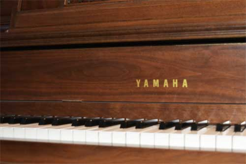 Yamaha console piano logo At 88 Keys Piano Warehouse