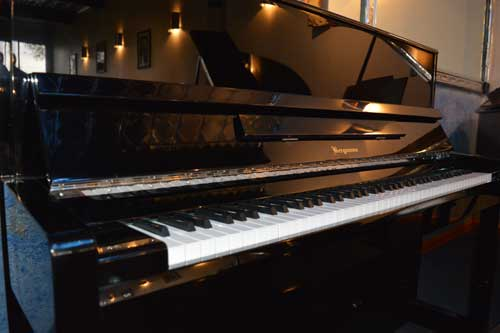 Bergmann upright piano keyboard at 88 Keys Piano Warehouse