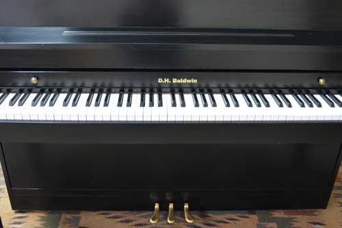 DH Baldwin console piano keyboard at 88 Keys Piano Warehouse