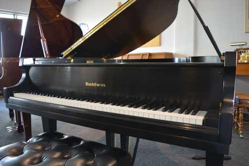 Baldwin Grand piano logo at 88 Keys Piano Warehouse