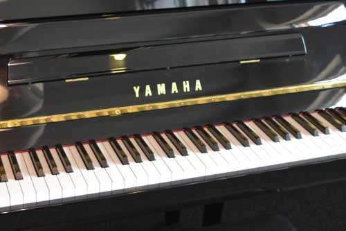 Yamaha studio piano logo at 88 Keys Piano Warehouse