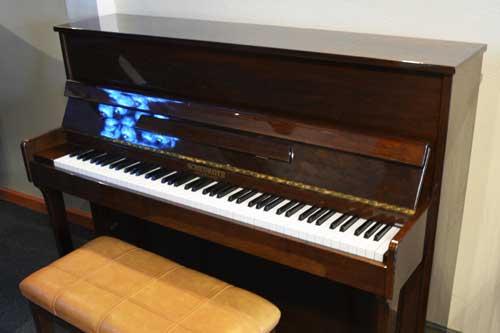 Schiedmayer studio piano side view at 88 Keys Piano Warehouse