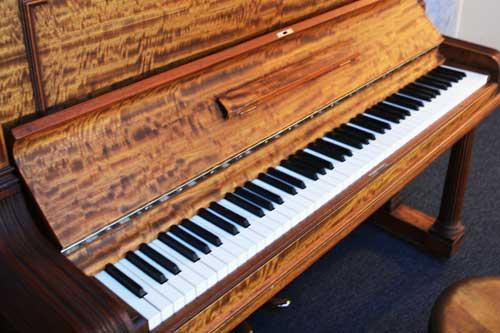 Steinway MOdel K upright piano close up at 88 Keys Piano Warehouse