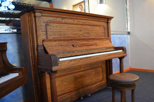 Steinway Model K upright piano left side view at 88 Keys Piano Warehouse
