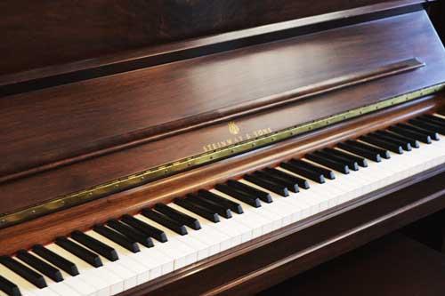 Steinway model K upright piano logo at 88 Keys Piano warehouse