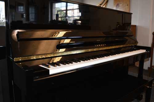 Yamaha T-118 upright piano side view at 88 Keys Piano Warehouse